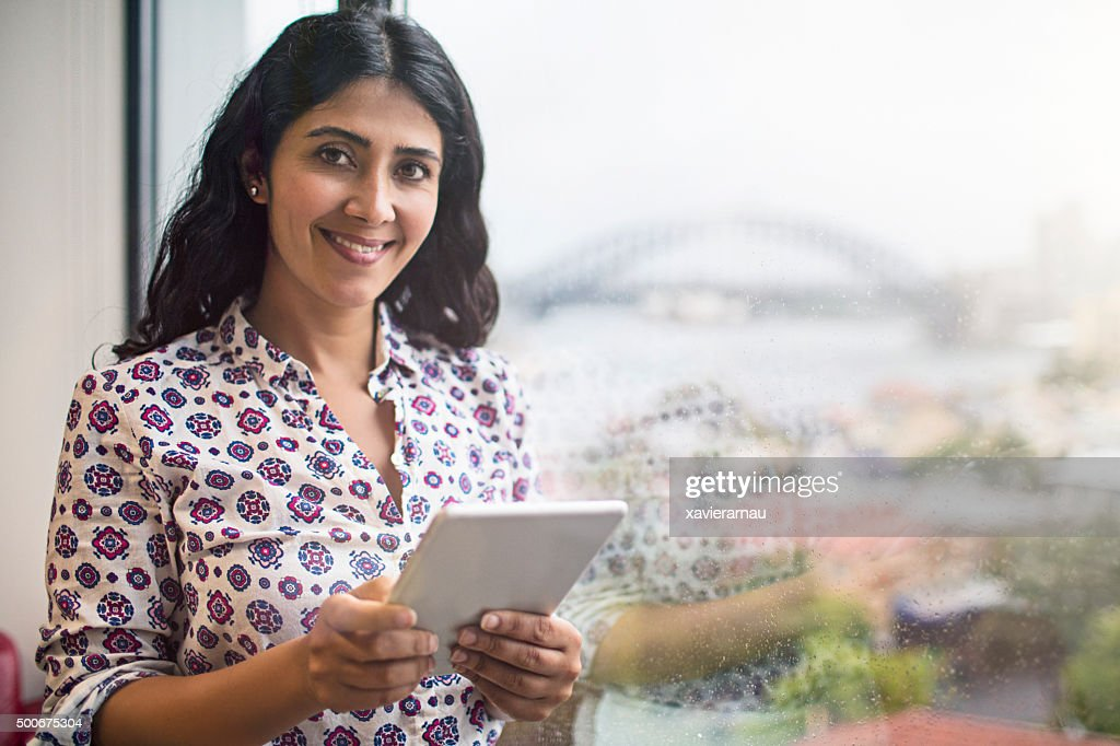 Businesswoman portrait in the office next to the window : Stock Photo