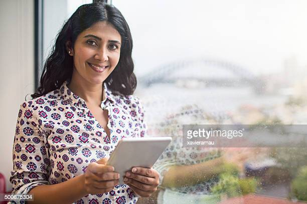 businesswoman portrait in the office next to the window - iranian woman stock photos and pictures