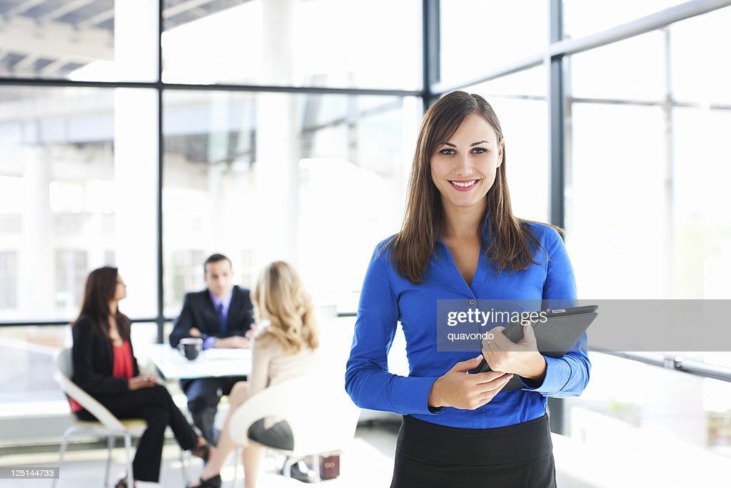 Businesswoman Portrait with Coworkers Meeting in Background, Copy Space : Stockfoto