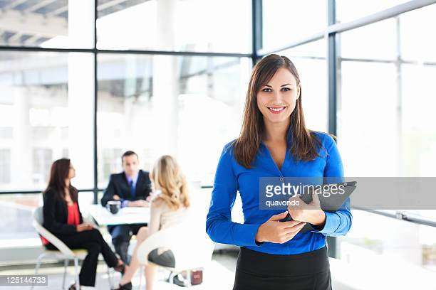 Businesswoman Portrait with Coworkers Meeting in Background, Copy Space