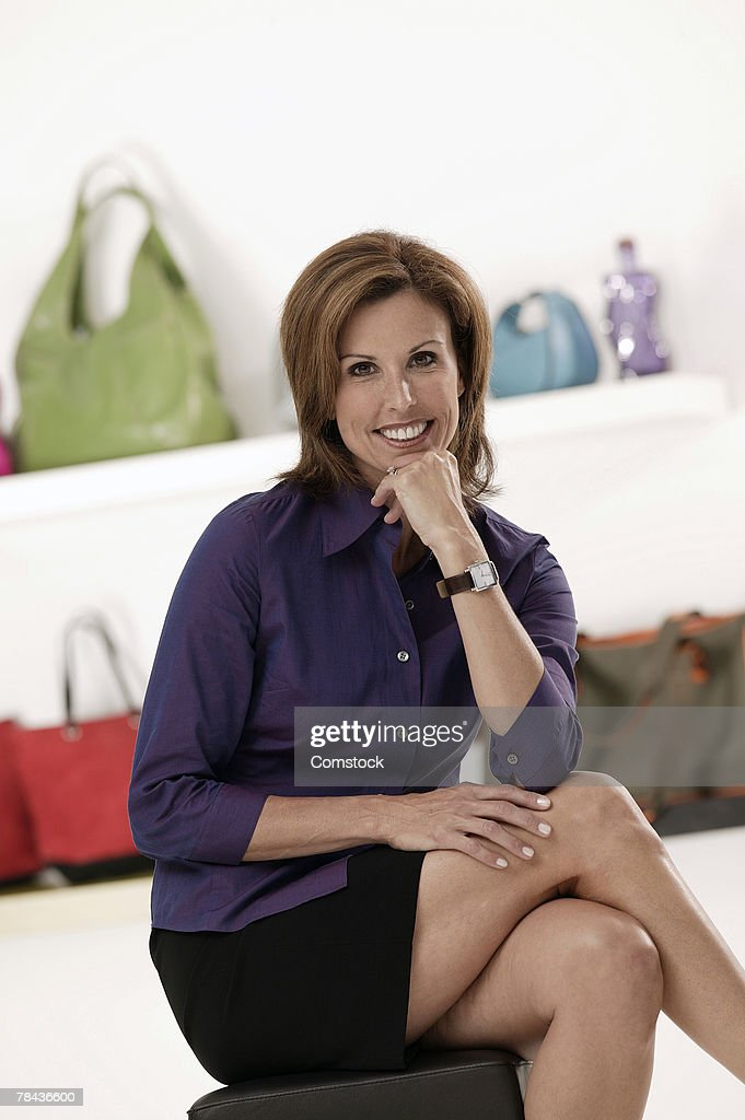 Businesswoman posing in accessories store : Stockfoto