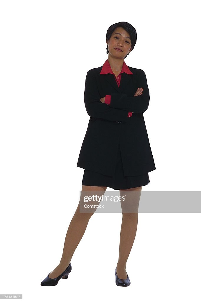 Businesswoman posing with arms folded : Stockfoto