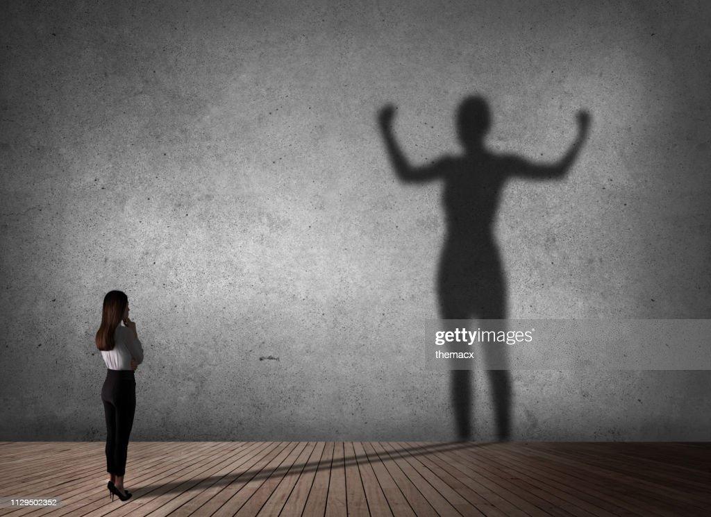 Businesswoman powerful of shadow : Stock Photo
