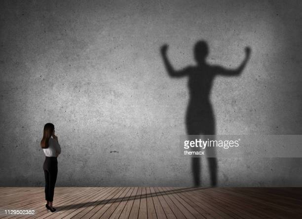 businesswoman powerful of shadow - confidence stock pictures, royalty-free photos & images