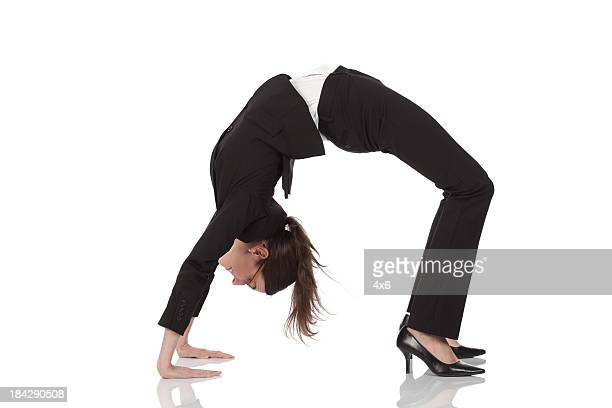 businesswoman practicing yoga - bending over backwards stock photos and pictures