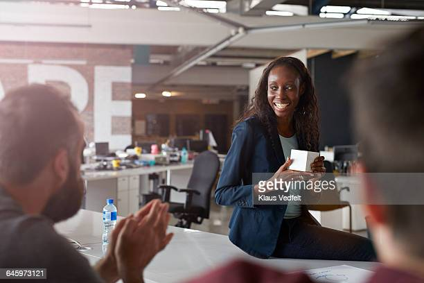 Businesswoman presenting in front of co-workers