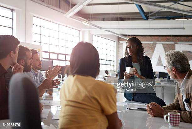 Businesswoman presenting product at meeting