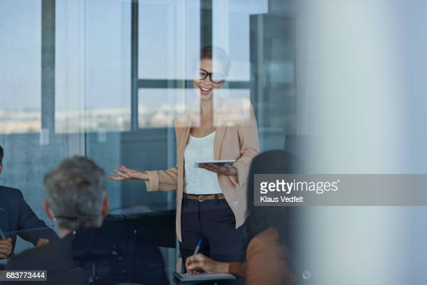 businesswoman presenting project in meeting room - selective focus stock pictures, royalty-free photos & images