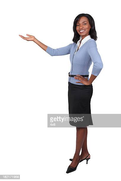 businesswoman presenting with arms - black skirt stock pictures, royalty-free photos & images