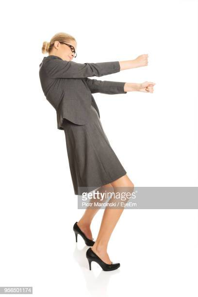 Businesswoman Pulling Against White Background