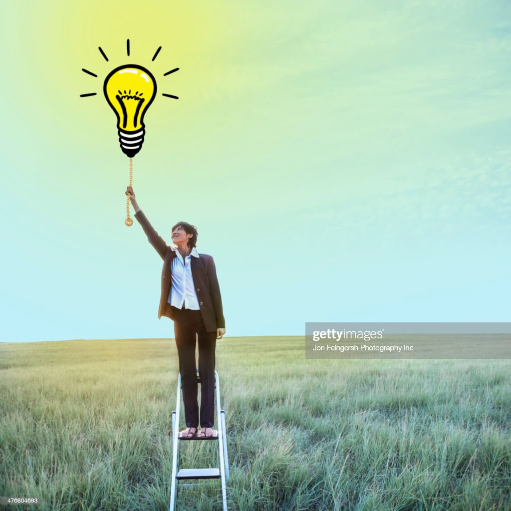 Businesswoman pulling chain on light bulb illustration : Stock Photo