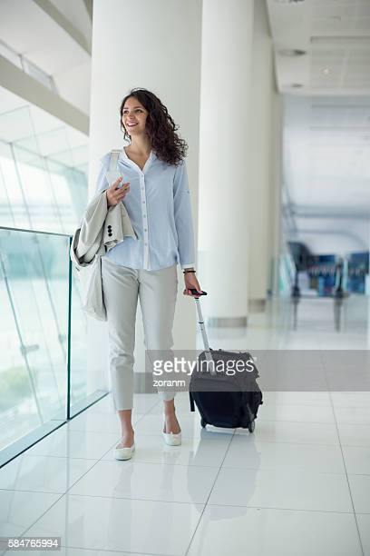 Businesswoman pulling luggage