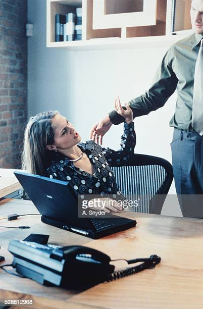 businesswoman pushing away businessman - sexual harassment stock pictures, royalty-free photos & images