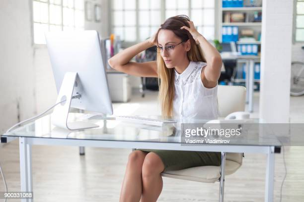 Businesswoman reading bad news