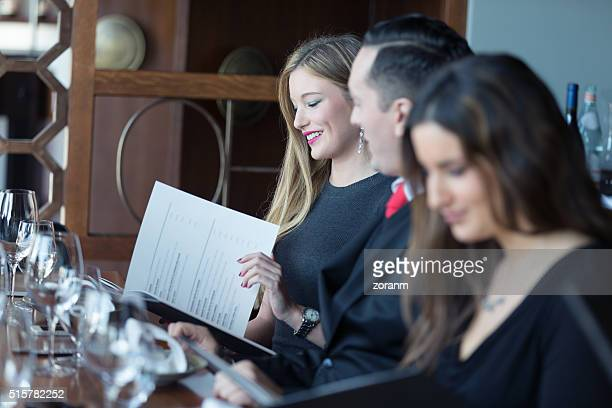 Businesswoman reading menu
