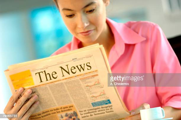 businesswoman reading newspaper - western script stock pictures, royalty-free photos & images