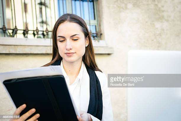 Businesswoman Reading Reports