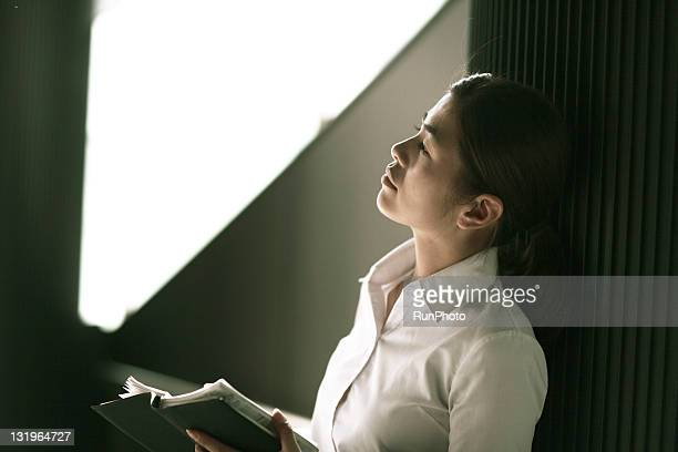 businesswoman reading the notebook