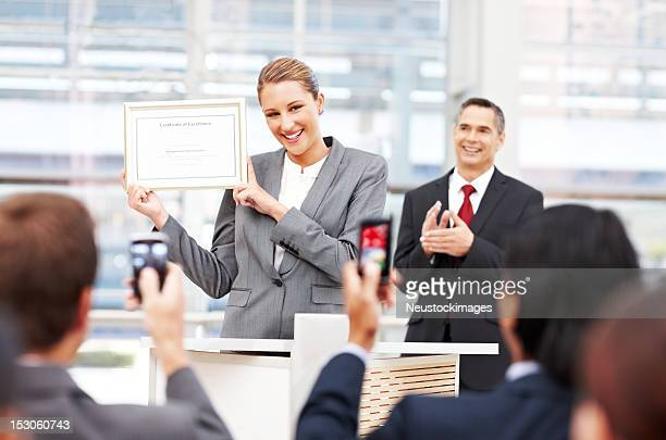 businesswoman receiving an award - awards ceremony stock pictures, royalty-free photos & images