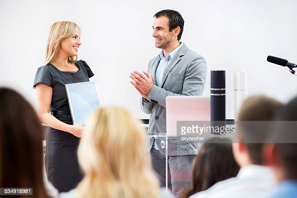 businesswoman receiving an award. - awards ceremony stock pictures, royalty-free photos & images