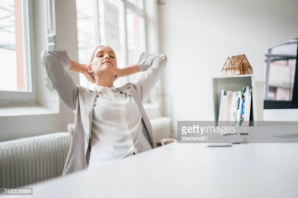 Businesswoman relaxing at desk in her office