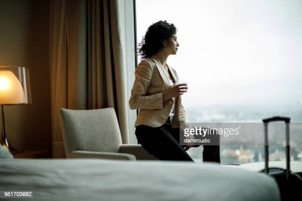 businesswoman relaxing in a hotel room - hotel stock pictures, royalty-free photos & images
