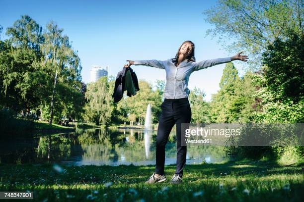 Businesswoman relaxing in the park