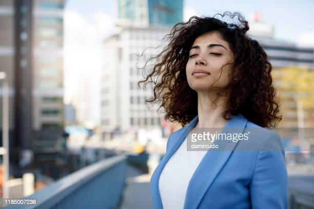 businesswoman relaxing outdoor - mindfulness stock pictures, royalty-free photos & images