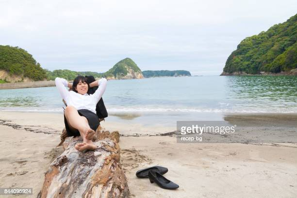 Businesswoman Resting At Beach