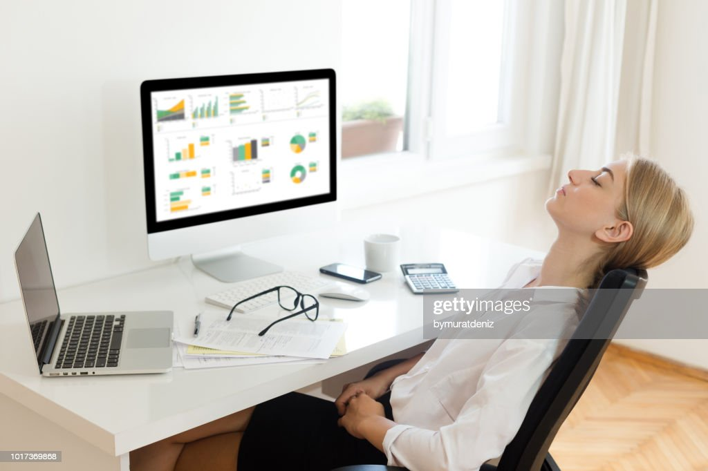 Businesswoman resting at office : Stock Photo