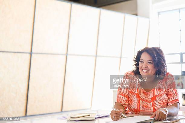 Businesswoman reviewing documents in office