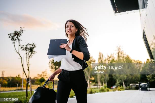 businesswoman running late in office - urgency stock pictures, royalty-free photos & images