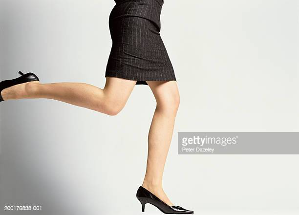 Businesswoman running, low section