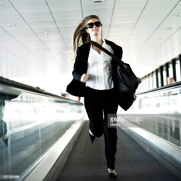 businesswoman running moving stairway - fast fashion stock pictures, royalty-free photos & images
