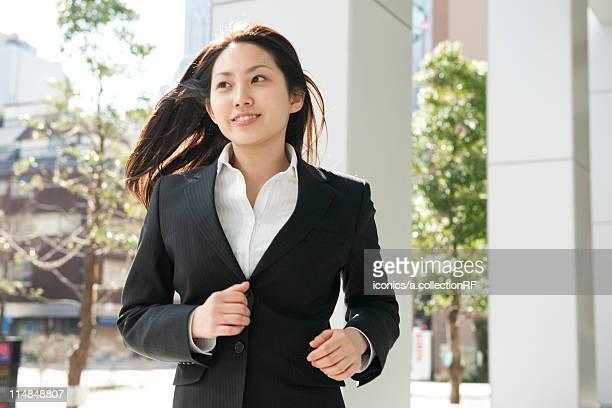 Businesswoman running, Tokyo Prefecture, Honshu, Japan