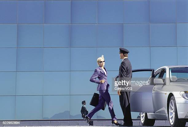 Businesswoman Running Towards Car