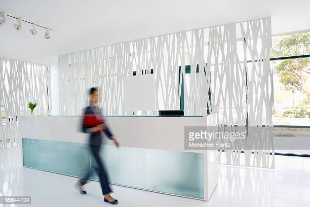 Businesswoman rushing through office lobby