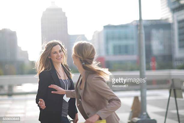 Businesswoman saying good bye to her colleague