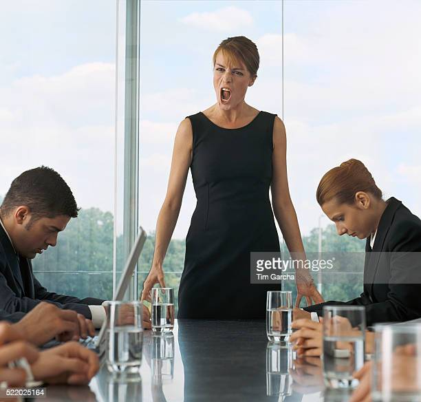 Businesswoman Scolding Employees During Meeting