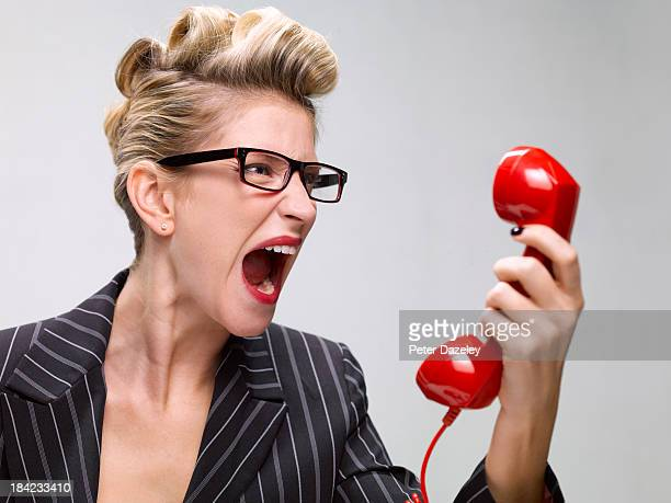 businesswoman screaming down phone - complaining stock pictures, royalty-free photos & images