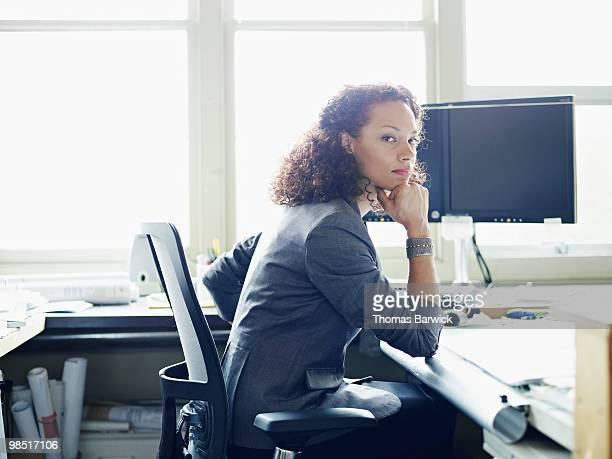 Businesswoman seated at desk in office