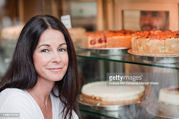 Businesswoman selecting cake in cafe