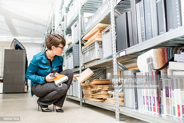 Businesswoman selecting wood sample