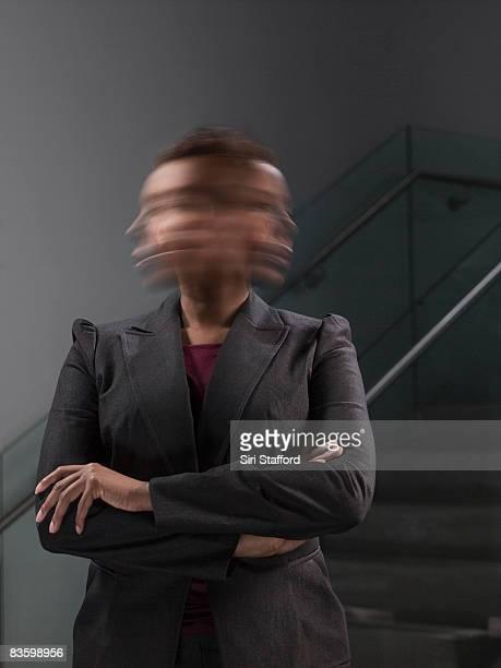 Businesswoman shaking head, blurred motion