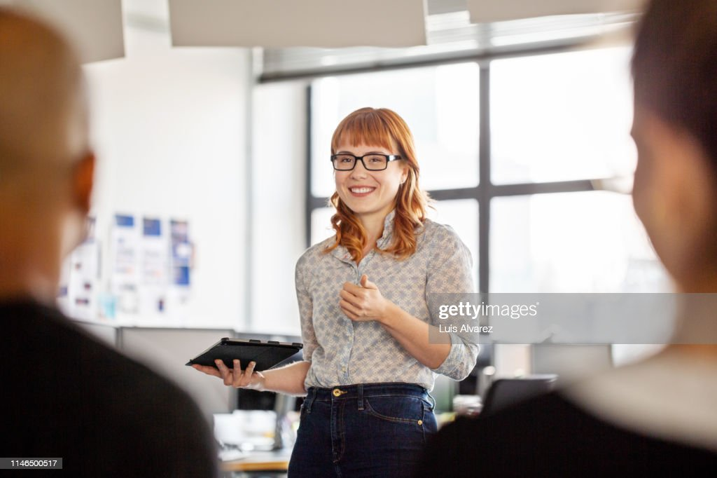 Businesswoman sharing her views with team : Stock Photo