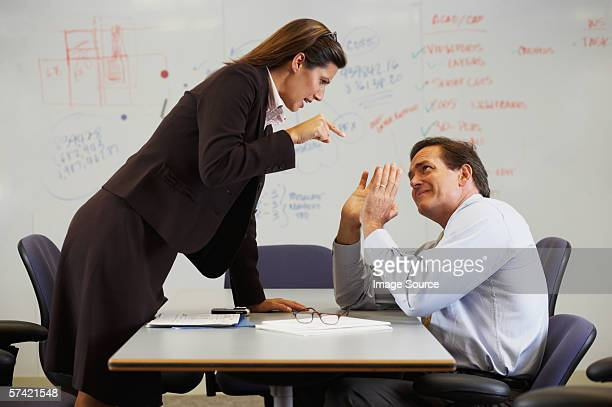 businesswoman shouting at colleague - domination stock pictures, royalty-free photos & images