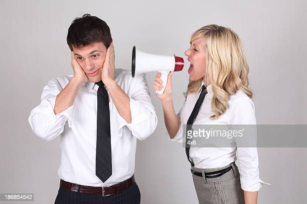 Businesswoman shouting in megaphone