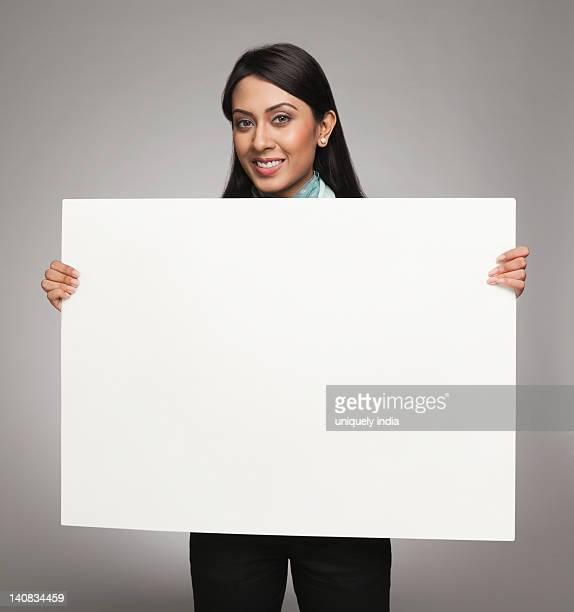 Businesswoman showing a placard and smiling