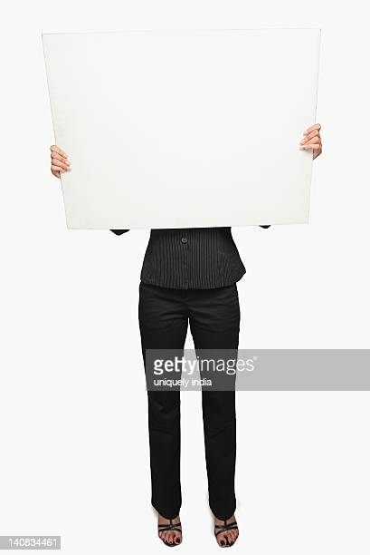 Businesswoman showing a placard