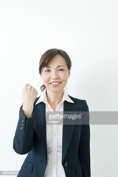 Businesswoman showing her fist